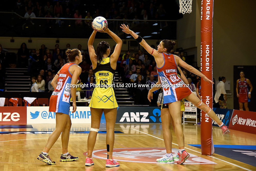 Pulse's Ameliaranne Wells (C takes a shot at goal with Swifts' Sharni Layton (R and  Micaela Wilson in defense during the ANZ Championship - Pulse v Swifts netball match at the TSB Arena in Wellington on Saturday the 25th of April 2015. Photo by Marty Melville / www.Photosport.co.nz