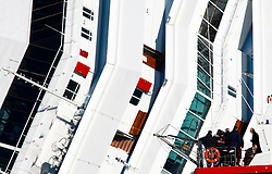 Francesco Verusio (4th R), general prosecutor of Grosseto, views the Costa Concordia cruise ship from a Carabinieri boat, off the west coast of Italy on Giglio island January 26, 2012. <br /> REUTERS/Darrin Zammit Lupi (ITALY)