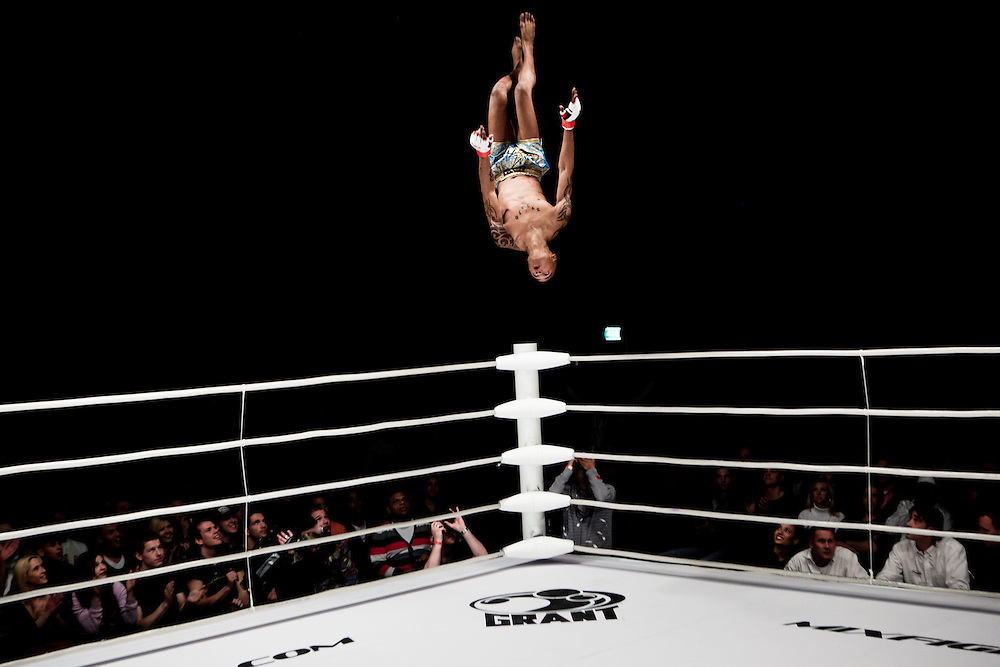 "Viktor ""Tigri"" Kuku is doing a backward flip following his victory at the M-1 selection tournament Western Europe."