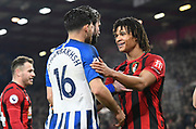 Nathan Ake (5) of AFC Bournemouth try to calm down Alireza Jahanbakhsh (16) of Brighton and Hove Albion during the Premier League match between Bournemouth and Brighton and Hove Albion at the Vitality Stadium, Bournemouth, England on 21 January 2020.