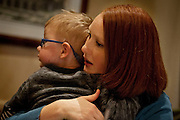 Carter Davidson is comforted by his mother Sedra after a small meltdown during lunch at BRIO Tuscan Grill in Murray, Friday, Nov. 9, 2012.