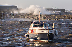 Stormy weather in East Lothian 11 January 2017; waves crash against the wall at Cockenzie Harbour.<br /> <br /> (c) Chris McCluskie | Edinburgh Elite media