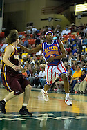 05 May 2006: Keiron 'Sweet P' Shine dishes a no look pass in the Harlem Globetrotters basketball game vs the New York Nationals at the Sulivan Arena in Anchorage Alaska during their 80th Anniversary World Tour.