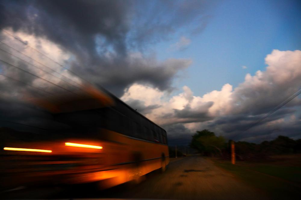 Evening traffic on the south coast road from Santiago de Cuba to Pilon.