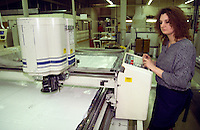 Woman operating an Gerber cutting machine. SR Gent Barnsley. 26/2/1991.