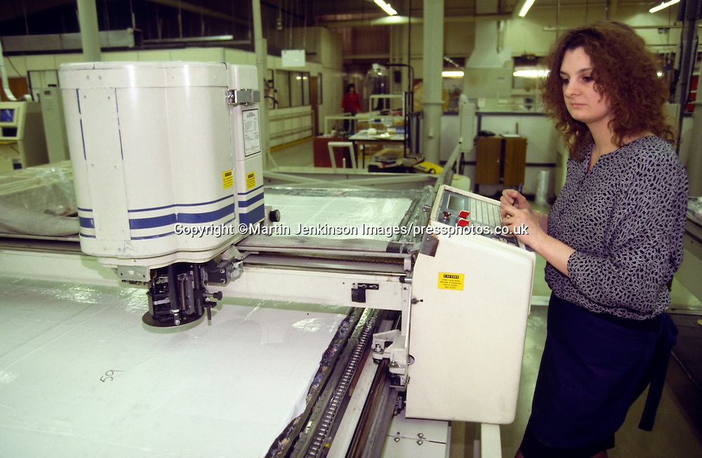 Woman operating an Gerber cutting machine. SR Gent Barnsley. 26/2/1991.