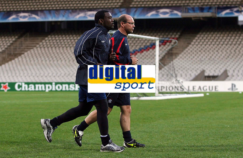 Photo: Paul Thomas.<br /> Rangers Training session. UEFA Champions League. 01/10/2007.<br /> <br /> Striker Jean-Claude Darcheville of Rangers races to be fit for the game tomorrow.