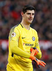"""Chelsea goalkeeper Thibaut Courtois during the Premier League match at Old Trafford, Manchester. PRESS ASSOCIATION Photo. Picture date: Sunday February 25, 2018. See PA story SOCCER Man Utd. Photo credit should read: Martin Rickett/PA Wire. RESTRICTIONS: EDITORIAL USE ONLY No use with unauthorised audio, video, data, fixture lists, club/league logos or """"live"""" services. Online in-match use limited to 75 images, no video emulation. No use in betting, games or single club/league/player publications."""