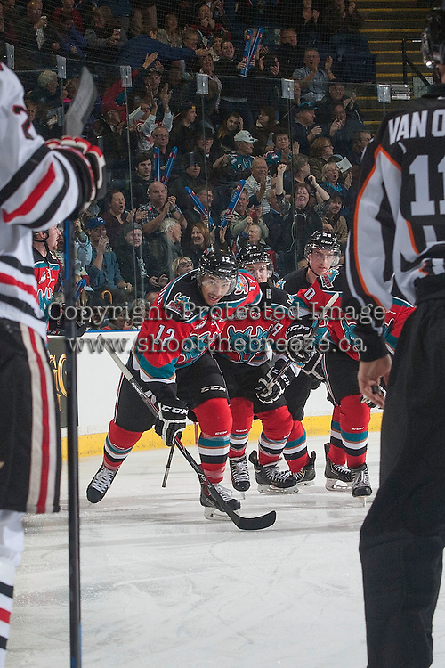 KELOWNA, CANADA - NOVEMBER 21: The Kelowna Rockets celebrate a goal against the Portland Winterhawks on November 21, 2014 at Prospera Place in Kelowna, British Columbia, Canada.  (Photo by Marissa Baecker/Shoot the Breeze)  *** Local Caption *** Colten Martin; Nick Merkley; Tyrell Goulbourne;