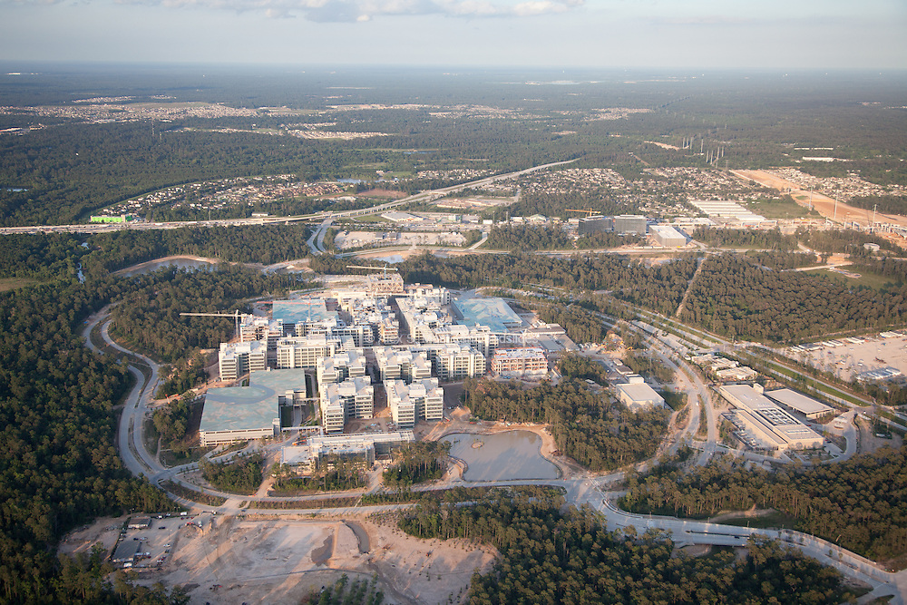 Exxon's world headquarters under construction outside of Houston. Bucolic scenes, visible only from the air, beautify massive garages for the 10,000 commuting employees.