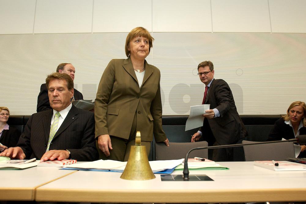 27 APR 2004, BERLIN/GERMANY:<br /> Michael Glos (L), CSU, Stellv. Fraktionsvorsitzender, und Angela Merkel (R), CDU Bundesvorsitzende, vor Beginn der CDU/CSU Fraktionssitzung, Deutscher Bundestag<br /> IMAGE: 20040427-03-005<br /> KEYWORDS: Sitzung