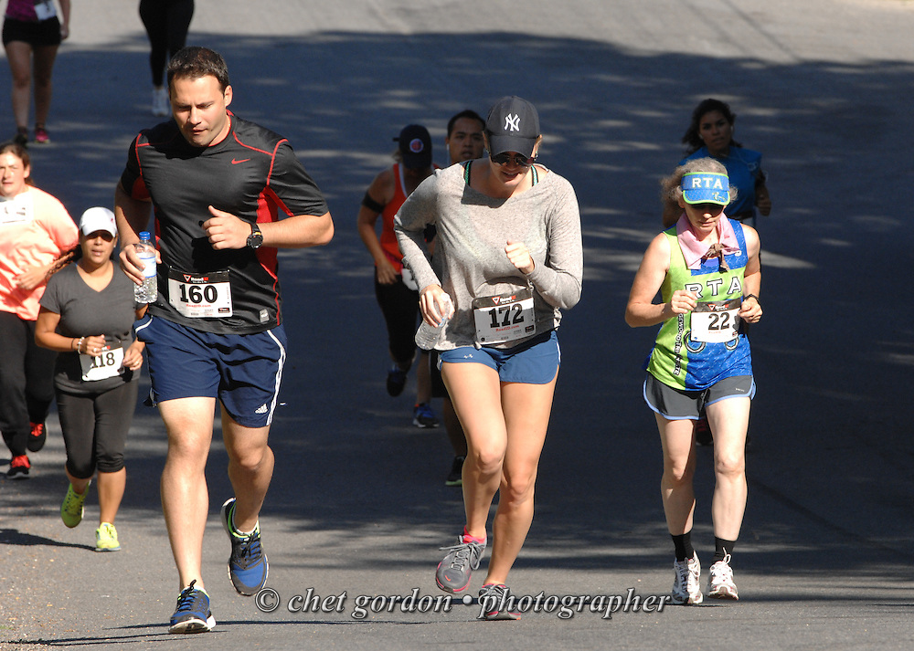 Runners make their way uphill during the Greenwood Lake Inaugural 5K Run in Greenwood Lake, NY on Saturday, August 9, 2014.  © Chet Gordon/THE IMAGE WORKS