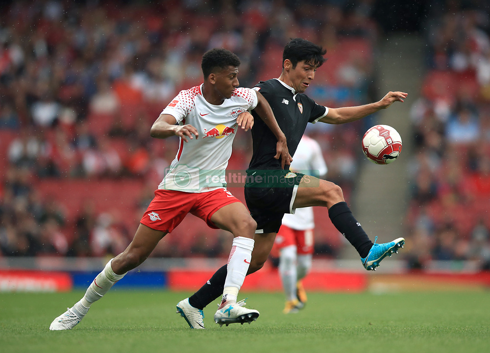 RB Leipzig's Bernardo (left) and Sevilla's Boria Lasso battle for the ball during the Emirates Cup match at the Emirates Stadium, London.