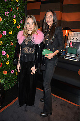 Left to right, sisters ROSIE FORTESCUE and LILY FORTESCUE at a private dinner for designer Ethan K held at Blakes Hotel, 33 Roland Gardens, London on 26th October 2016.