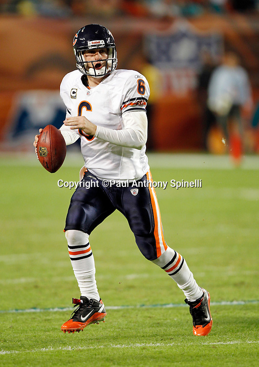 Chicago Bears quarterback Jay Cutler (6) rolls out while looking to pass during the NFL week 11 football game against the Miami Dolphins on Thursday, November 18, 2010 in Miami Gardens, Florida. The Bears won the game 16-0. (©Paul Anthony Spinelli)