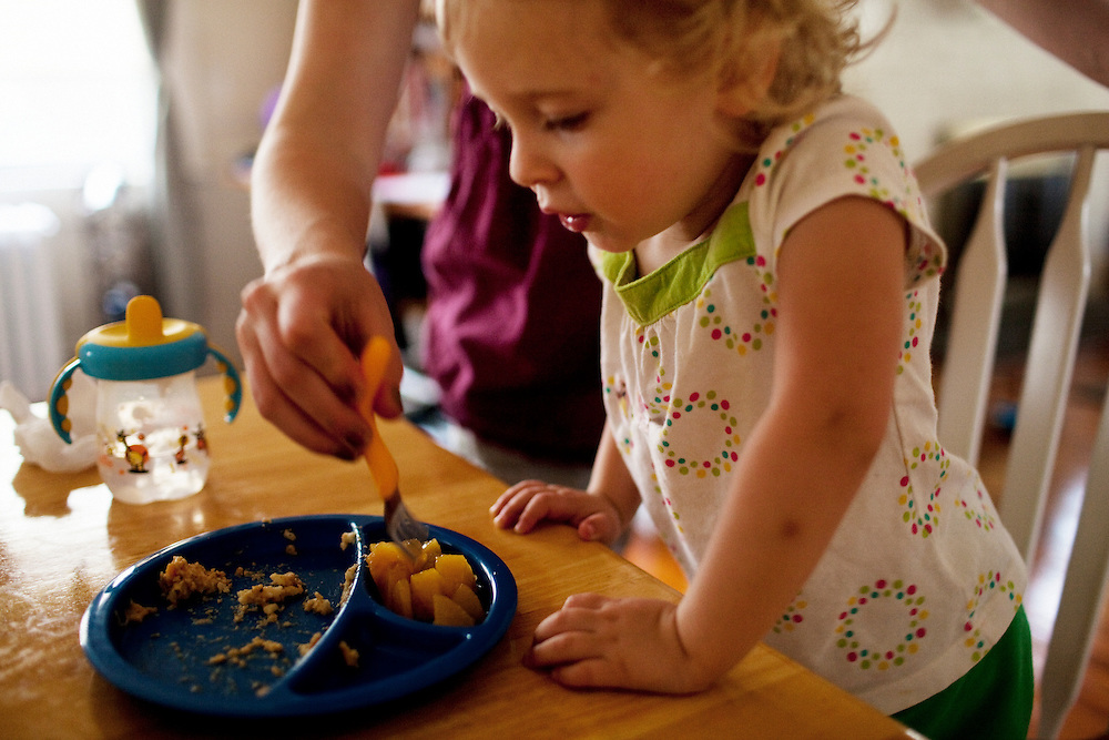 Madelyn Eich, 2, is helped eat dinner by her mother Melissa after waking from a nap in Norfolk, Virginia on Sunday, May 2, 2010.
