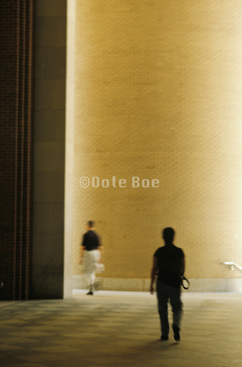 figures walking on interior courtyard