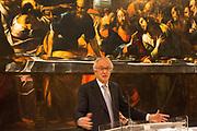 Giovanni Bazoli, President Emeritus of Intesa Sanpaolo Bank, speaks at the press conference to present the exhibition of L'Ultimo Caravaggio, eredi e nuovi maestri (Last Caravaggio, Heirs and new Masters) at Gallerie d'Italia, Intesa Sanpaolo Museum, in Milan on November 30, 2017. In the backgroud Ultima cena, oil on canvas, by Giulio Cesare Procaccini. © Carlo Cerchioli