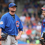 NEW YORK, NEW YORK - July 03: Pitcher Jon Lester #34 of the Chicago Cubs and catcher David Ross #3 of the Chicago Cubs on the mound before Lester was removed after giving up seven runs in the second inning during the Chicago Cubs Vs New York Mets regular season MLB game at Citi Field on July 03, 2016 in New York City. (Photo by Tim Clayton/Corbis via Getty Images)