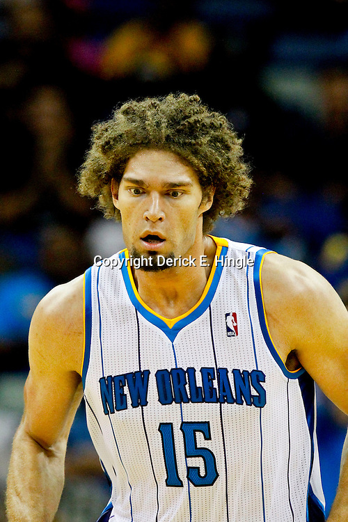 October 24, 2012; New Orleans, LA, USA; New Orleans Hornets center Robin Lopez (15) against the Houston Rockets during the first half of a preseason game at the New Orleans Arena.   Mandatory Credit: Derick E. Hingle-US PRESSWIRE