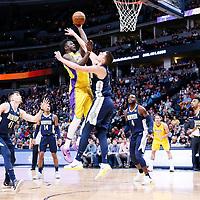 09 March 2018: Los Angeles Lakers forward Julius Randle (30) goes for the jump shot over Denver Nuggets center Nikola Jokic (15) during the Denver Nuggets125-116 victory over the Los Angeles Lakers, at the Pepsi Center, Denver, Colorado, USA.