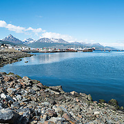 The rocky waterfront of Ushuaia Port, Argentina.