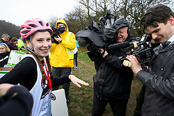 © Licensed to London News Pictures. 03/03/2019. Dorking, UK. Winner of the race TANISHA PRINCE shows off her engagement ring to media after her partner in the race, CHRIS HEPWORTH proposed at the finish line. Competitors take part in the 2019 annual Wife Carrying Race in Dorking, Surrey. Run over a course of 380m, with both men and women carry a 'wife' over obstacles, the race is believed to have originated in the UK over twelve centuries ago when Viking raiders rampaged into the northeast coast of England carrying off any unwilling local women . Photo credit: Ben Cawthra/LNP