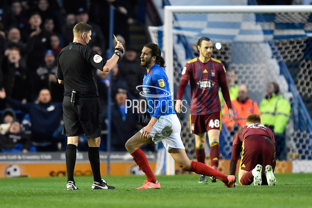 Christian Burgess (6) of Portsmouth is shown a yellow card, booked during the EFL Sky Bet League 1 match between Portsmouth and Ipswich Town at Fratton Park, Portsmouth, England on 21 December 2019.
