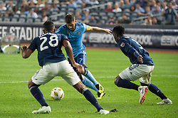 September 5, 2018 - Bronx, New York, United States - New York City forward DAVID VILLA #7 dribbles the ball against New England Revolution defender MICHAEL MANCIENNE #28 during a regular season match at Yankee Stadium in Bronx, NY.  New England Revolution defeats New York City FC 1 to 0 (Credit Image: © Mark Smith/ZUMA Wire)