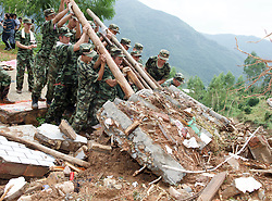 QUANZHOU, Sept. 16, 2016 (Xinhua) -- Rescuers search for survivors at a landslide area in Nan'an, southeast China's Fujian Province, Sept. 16, 2016. Disaster relief and reconstruction were launched after Typhoon Meranti swept away and left severe damages. (Xinhua/Jiang Kehong) (cxy) (Credit Image: © Jiang Kehong/Xinhua via ZUMA Wire)
