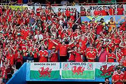 PARIS, FRANCE - Saturday, June 25, 2016: Wales' supporters celebrate the 1-0 victory over Northern Ireland and reaching the Quarter-Final during the Round of 16 UEFA Euro 2016 Championship match at the Parc des Princes. (Pic by David Rawcliffe/Propaganda)