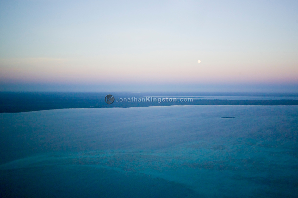 An aerial view at dusk of the east coast of, Zanzibar, on the Indian Ocean, Tanzania.