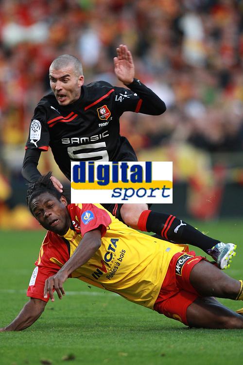 FOOTBALL - FRENCH CHAMPIONSHIP 2010/2011 - L1 - RC LENS v STADE RENNAIS - 17/10/2010 - PHOTO ERIC BRETAGNON / DPPI -  JEROME LEROY (RENNES) / HENRI BEDIMO (RCL)
