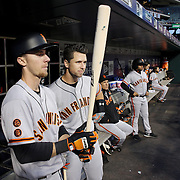 NEW YORK, NEW YORK - APRIL 29:  Catcher Buster Posey #28, (right) and Matt Duffy #5 of the San Francisco Giants preparing to bat in the dugout during the New York Mets Vs San Francisco Giants MLB regular season game at Citi Field on April 29, 2016 in New York City. (Photo by Tim Clayton/Corbis via Getty Images)