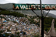 Tarps and tents cover the hillside neighborhood La Vallee de Bourdon in Port-au-Prince, Haiti, in July 2010, seven months after the devastating magnitude-7 earthquake.