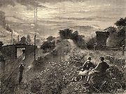 The countryside scarred by mining. A typical scene in the Northumberland and Durham mining districts of northern England. On the right of the picture is the top of an inclined plane for transporting coal away from the pit head. The weight of the loaded wagons going down the incline hauled up the empty wagons to the top of the incline on a parallel track. In the background, right, spoil tips are being created, while on the left the chimneys of steam engines emit smoke.  Engraving from 'The Graphic' (London, 18 February 1871).
