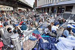 © Licensed to London News Pictures. 29/10/2017. London, UK.  Fans of singer, Harry Styles, queue up outside the Hammersmith Eventim Apollo in West London ahead of his first UK solo shows taking place on 29 and 30 October.  Many fans, eager to secure a space as close to the stage as possible have queued overnight, sleeping on the pavement in their sleeping bags or under duvets.  Fans immediately outside the entrance to the venue (pictured) will be seeing the singer perform on the 29 October, whilst those under the nearby Hammersmith flyover have arrived a day early with tickets for 30 October.  Photo credit: Stephen Chung/LNP
