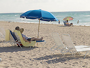 elderly couple having a leisurely day one the beach Miami USA