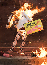 "© Licensed to London News Pictures. 26/11/2016. London, UK. A burning effigy of Jeremy Hunt holds up a Sex Pistols credit card mocking financial companies. Joe Corre (top right), the son of former Sex Pistol manager Malcolm McLaren and Vivienne Westwood burns his personal collection of Sex Pistols punk memorabilia. Earlier this week Joe Corre said that punk has become nothing more than a ""McDonald's brand ... owned by the state, establishment and corporations"". His collection is estimated to be worth £5 million. Photo credit: Peter Macdiarmid/LNP"