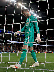 Manchester United goalkeeper David de Gea appears dejected after Manchester City's Ilkay Gundogan (not in picture) scores his side's third goal of the game during the Premier League match at the Etihad Stadium, Manchester.