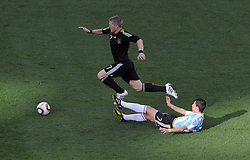 Bastian SCHWEINSTEIGER beats  Angel DI MARIA  during the 2010 FIFA World Cup South Africa Quarter Final match between Germany and Argentina at the Green Point  Stadium on July 3, 2010 in Cape town, South Africa.