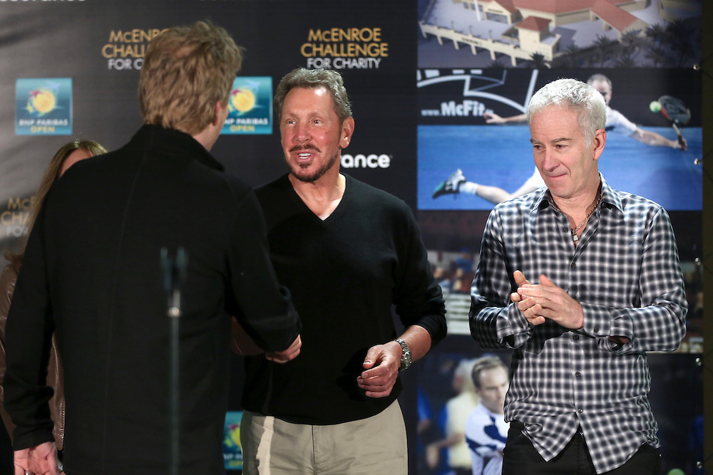 February 28, 2014, Palm Springs, California: <br /> Tournament owner Larry Ellison shakes hands with Jim Courier during the McEnroe Challenge for Charity VIP Draw Ceremony in the newly constructed Stadium 2 at the Indian Wells Tennis Garden. <br /> (Photo by Billie Weiss/BNP Paribas Open)