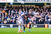 Queens Park Rangers defender Conor Masterson (23) fouls Leeds United forward Patrick Bamford (9) during the EFL Sky Bet Championship match between Queens Park Rangers and Leeds United at the Kiyan Prince Foundation Stadium, London, England on 18 January 2020.