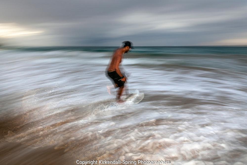 HI00403-00...HAWAI'I - Kaleo Carpio skim boarding at Hapuna Beach State Recreation Area on the island of Hawai'i. (MR# C14)