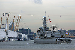© Licensed to London News Pictures. 29/11/2013. Belgian frigate BNS LOUISE MARIE carrying sacred soil from the battlefields of Flanders to London. Pictured here at the Thames Barrier and approaching the O2, she is due to moor alongside HMS Belfast after Tower Bridge has fully opened in full salute. The soil she is carrying is destined for a new memorial garden. Credit : Rob Powell/LNP