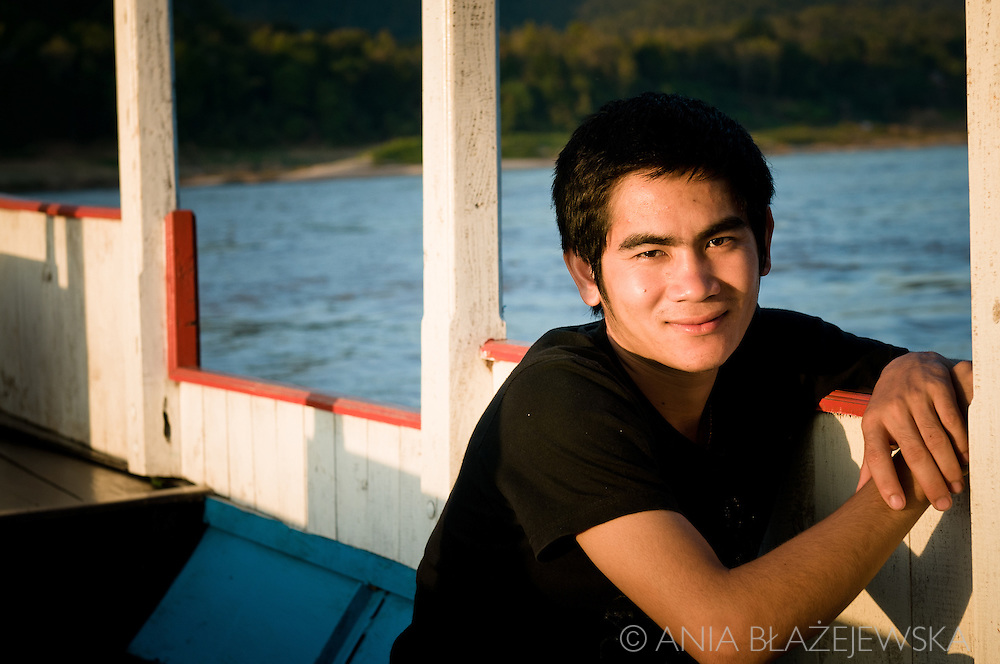 Laos, Luang Prabang. Portrait of a boat driver on the Mekong river.