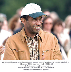 ALI ALBWARDY patron of the Dubai polo team at a polo match in West Sussex on 18th July 2004.PXG 95