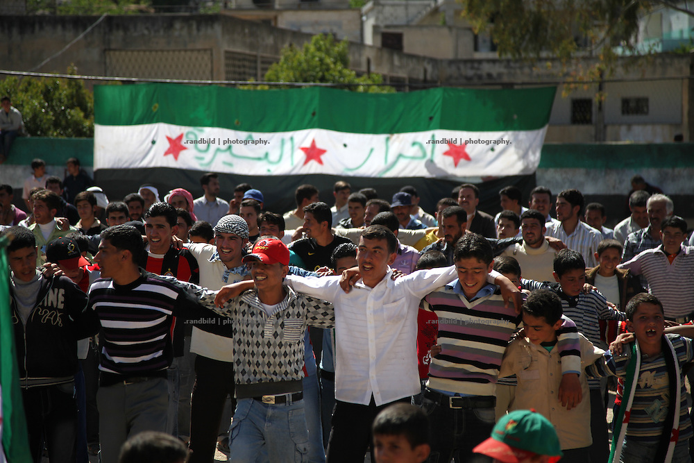 A monday gathering of 500 women and men to demonstrate against Assad in the village of Bashirija which was beeing attacked by syrian Army in early April, leaving serveral people dead. Many houses were set on fire and livestock were shot dead by Assad loyal forces raging for two days. Later nighbours buried bodies of inhabitants hasty in a mass grave.