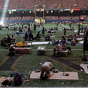 Thousands of evacuees lived under squalled conditions inside the Superdome while they waited  to be evacuated after Hurricane Katrina hit New Orleans and the Gulf Coast.