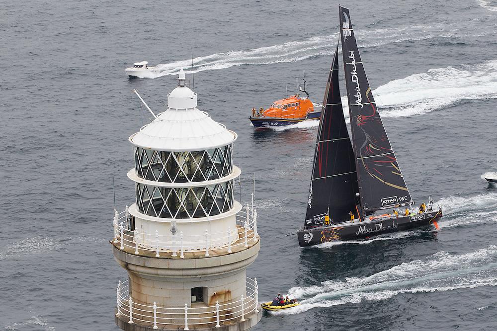 IRELAND, Fastnet Rock. 2nd July 2012. Volvo Ocean Race, Leg 9, Lorient to Galway. Abu Dhabi Ocean Racing rounds the Fastnet Rock.
